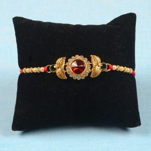 Red Gemstone Rakhi with Golden Leaf